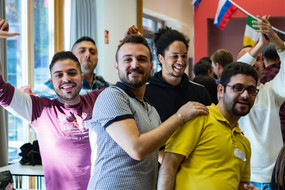 A group of smiling men at the International Meeting Center IBZ