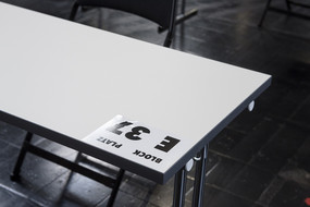 "A white table with a note with the inscription ""Section E, Seat 37"""
