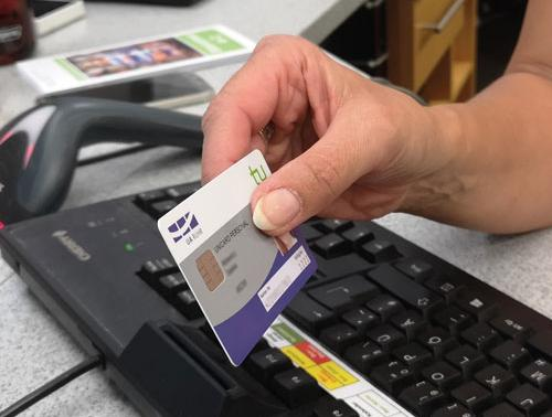 A hand holding a white and blue chip card.