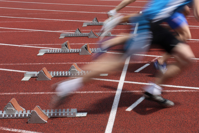 The moment a group of sprinters start their race from their starting blocks at a running track