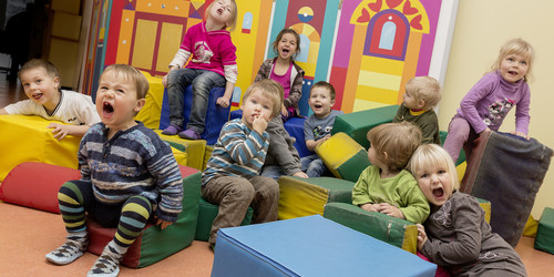 A group of little children playing inside a kindergarden