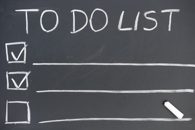 "The title ""To Do List"" is written on a black board."