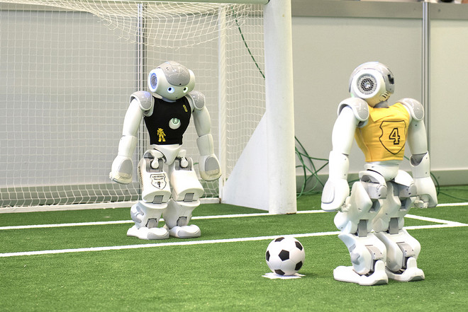 Two robots playing football (soccer)