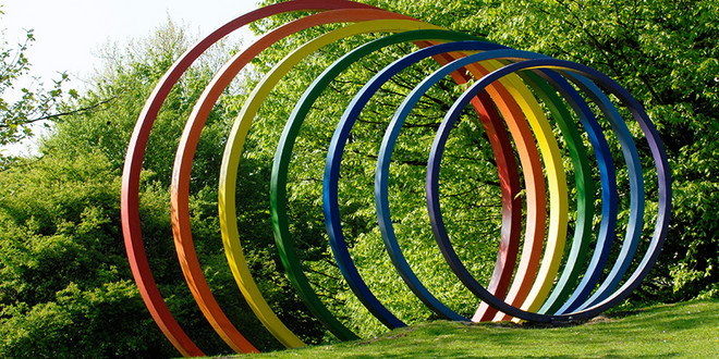 Sculpture of seven colourful rings of different sizes
